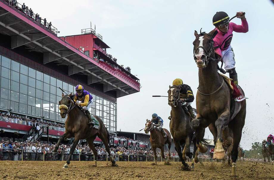 Tyler Gaffalione rides War of Will, right, to a first-place finish during the 144th running of the Preakness Stakes at Pimlico Race Course on Saturday. Photo: Washington Post Photo By Toni L. Sandys / The Washington Post