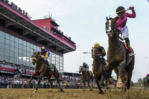 Tyler Gaffalione rides War of Will, right, to a first-place finish during the 144th running of the Preakness Stakes at Pimlico Race Course on Saturday.
