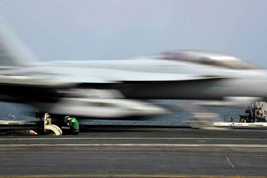 "In this Thursday, May 16, 2019 photograph released by the U.S. Navy, Aviation Boatswain's Mate Airman Kayla Pettit operates a center deck station as an F-18 Super Hornet takes off from the USS Abraham Lincoln aircraft carrier in the Arabian Sea. On Saturday, May 18, 2019, U.S. diplomats warned that commercial airliners flying over the wider Persian Gulf faced a risk of being ""misidentified"" amid heightened tensions between the U.S. and Iran. (Mass Communication Specialist 3rd Class Jeff Sherman, U.S. Navy via AP) Photo: 3rd Class Jeff Sherman / U.S. Navy"