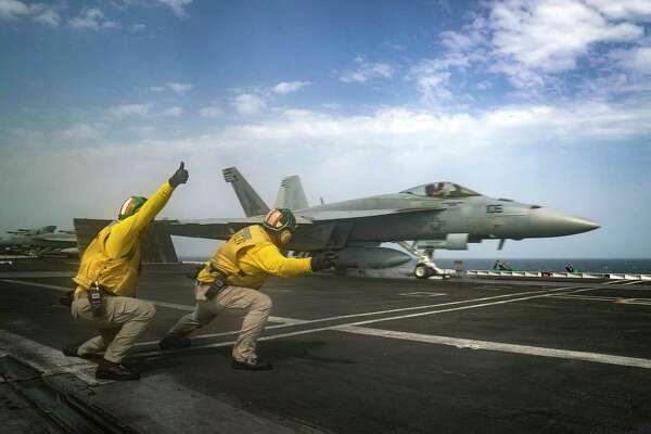 "In this Thursday, May 16, 2019 photo released by the U.S. Navy, Lt. Nicholas Miller, from Spring, Texas, and Lt. Sean Ryan, from Gautier, Miss., launch an F-18 Super Hornet from the deck of the USS Abraham Lincoln aircraft carrier in the Arabian Sea. On Saturday, May 18, 2019, U.S. diplomats warned that commercial airliners flying over the wider Persian Gulf faced a risk of being ""misidentified"" amid heightened tensions between the U.S. and Iran. (Mass Communication Specialist 3rd Class Jeff Sherman, U.S. Navy via AP)"