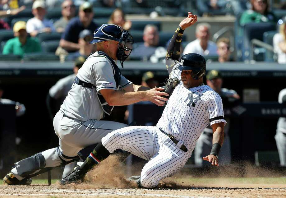 New York Yankees' Aaron Hicks, right, is tagged out at the plate by Tampa Bay Rays catcher Erik Kratz ending the sixth inning of a baseball game, Saturday, May 18, 2019, in New York. Hicks tried to score from second base on a base hit by Gleyber Torres. (AP Photo/Jim McIsaac) Photo: Jim McIsaac / Copyright 2019 The Associated Press. All rights reserved