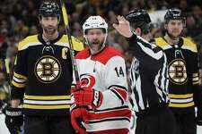 The Carolina Hurricanes' Justin Williams reacts during the second period against the Boston Bruins in Game 2 of the Eastern Conference Final during the Stanley Cup playoffs on May 12 in Boston.