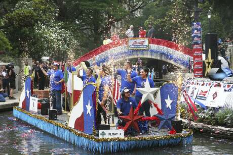 Fireworks emerge from a barge as floats in the Armed Forces Parade pass through the Arneson River Theatre on May 18, 2019.