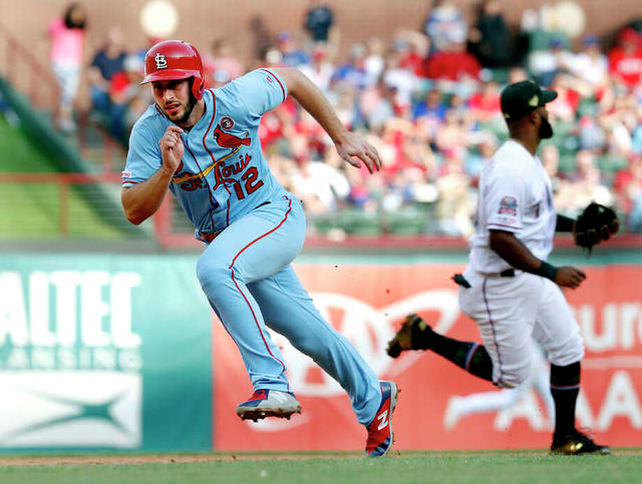The Cardinals' Paul DeJong (12) sprints around the bases, scoring on a Jose Martinez single as Texas Rangers' Danny Santana moves to cover second in the fifth inning Saturday's game in Arlington, Texas. Photo: AP Photo