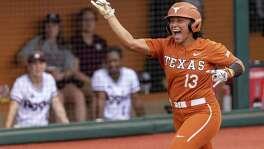 Texas' Shannon Rhodes (13) celebrates her home run against Texas A&M during Saturday's NCAA softball regional game.