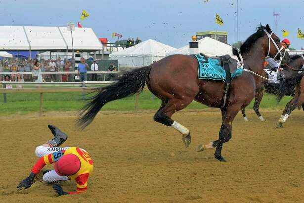 Jockey John Velazquez falls off of Bodexpress coming out of the gate during the running of the 144th Preakness Stakes on Saturday in Baltimore.