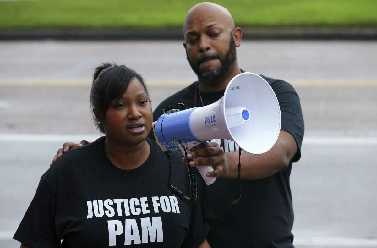T.J. Johnson speaks about her aunt Pamela Turner, who was killed during an altercation with Baytown Police officer Juan Delacruz Monday night, during a demonstration by the Black Lives Matter Houston group outside the Baytown Police Department Saturday, May 18, 2019, in Baytown, Texas. Turner was fatally shot during a confrontation with Delacruz at The Brixton Apartments complex, where she lived.