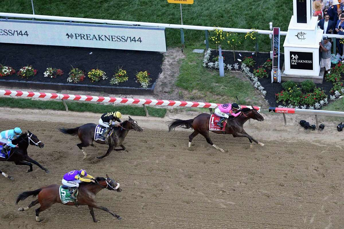 Jockey Tyler Gaffalione wins aboard War of Will during the Preakness Stakes horse race at Pimlico Race Course, Saturday, May 18, 2019, in Baltimore. Joel Rosario rides Everfast (10) for second and Florent Geroux rides Owendale for third.