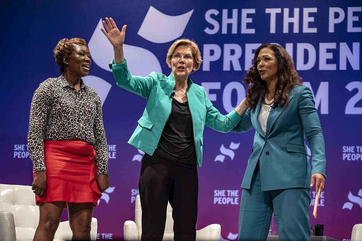 HOUSTON, TX - APRIL 24: (L-R) MSNBC host Joy Reid, Democratic presidential candidate Sen. Elizabeth Warren (D-MA) and She The People founder Aimee Allison address the crowd as Warren exits the stage at the She The People Presidential Forum at Texas Southern University on April 24, 2019 in Houston, Texas. Many of the Democrat presidential candidates are attending the forum to focus on issues important to women of color. (Photo by Sergio Flores/Getty Images)