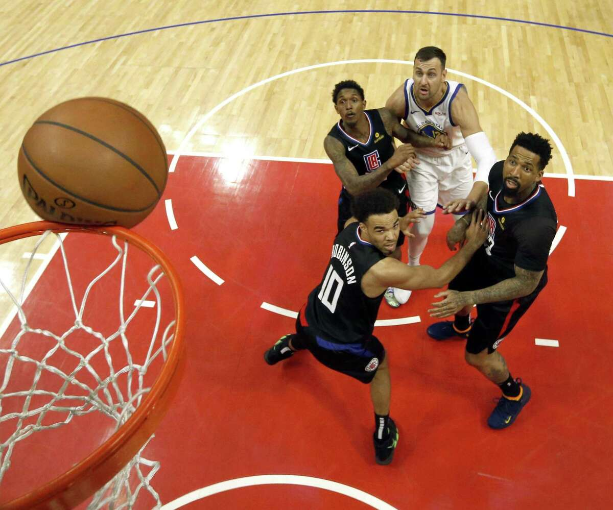 Clippers defenders box out Andrew Bogut in the second half as the Golden State Warriors played the Los Angeles Clippers in Game 4 of the First Round of the NBA Playoffs at Staples Center in Los Angeles on Sunday, April 21, 2019.