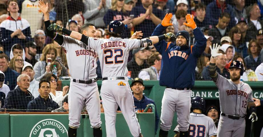 BOSTON, MA - MAY 18: Josh Reddick #22 of the Houston Astros celebrates with teammate after hitting a home run in the fifth inning against the Boston Red Sox at Fenway Park on May 18, 2019 in Boston, Massachusetts. (Photo by Kathryn Riley/Getty Images) Photo: Kathryn Riley/Getty Images