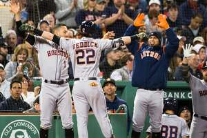 BOSTON, MA - MAY 18: Josh Reddick #22 of the Houston Astros celebrates with teammate after hitting a home run in the fifth inning against the Boston Red Sox at Fenway Park on May 18, 2019 in Boston, Massachusetts. (Photo by Kathryn Riley/Getty Images)