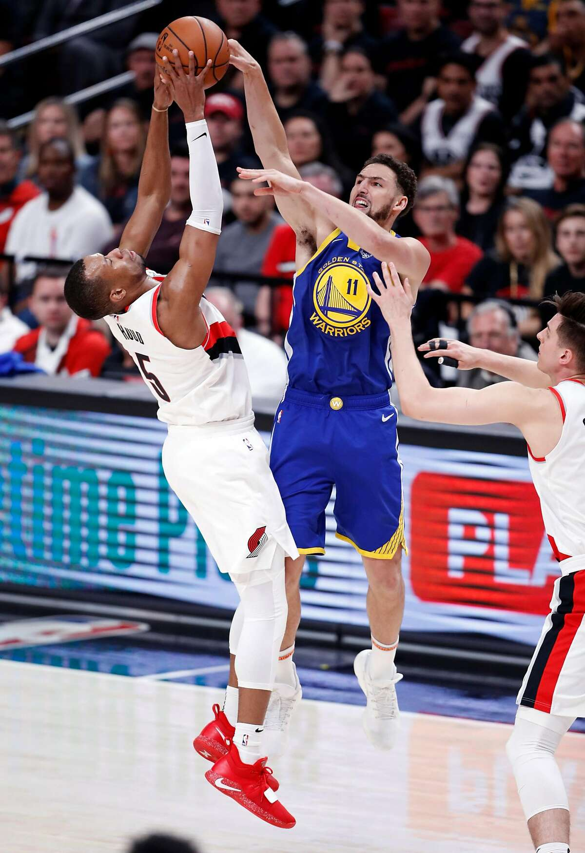 Golden State Warriors' Klay Thompson has the ball stolen by Portland Trail Blazers' Rodney Hood in 2nd quarter in Game 3 of the NBA Western Conference Finals at Moda Center in Portland, Oregon on Saturday, May 18, 2019.