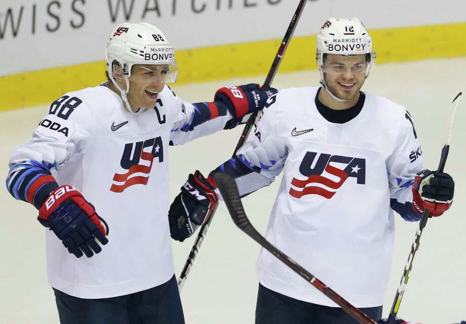 Alex Debrincat of the US, right, celebrates with teammate Patrick Kane, left, after scoring his sides fifth goal during the Ice Hockey World Championships group A match between Denmark and the United States at the Steel Arena in Kosice, Slovakia, Saturday, May 18, 2019. (AP Photo/Petr David Josek) Photo: Petr David Josek / Copyright 2018 The Associated Press. All rights reserved