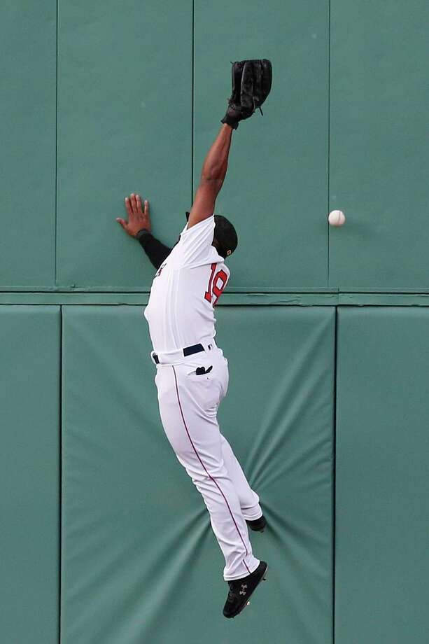 Boston Red Sox's Jackie Bradley Jr. misses the ball on a triple by Houston Astros' George Springer during the first inning of a baseball game in Boston, Saturday, May 18, 2019. (AP Photo/Michael Dwyer) Photo: Michael Dwyer / Copyright 2019 The Associated Press. All rights reserved