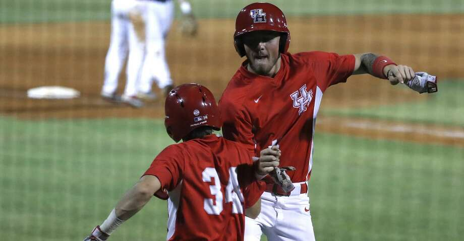 University of Houston Derrick Cherry (41) celebrates his run scored on a Rice Owls wild pitch with Kyle Lovelace (34)  in the 10th inning, where Houston scored six runs on one hit during an NCAA basball game at Reckling Park, Wednesday, May 1, 2019, in Houston . Photo: Karen Warren/Staff Photographer
