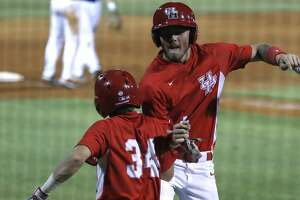 University of Houston Derrick Cherry (41) celebrates his run scored on a Rice Owls wild pitch with Kyle Lovelace (34)  in the 10th inning, where Houston scored six runs on one hit during an NCAA basball game at Reckling Park, Wednesday, May 1, 2019, in Houston .