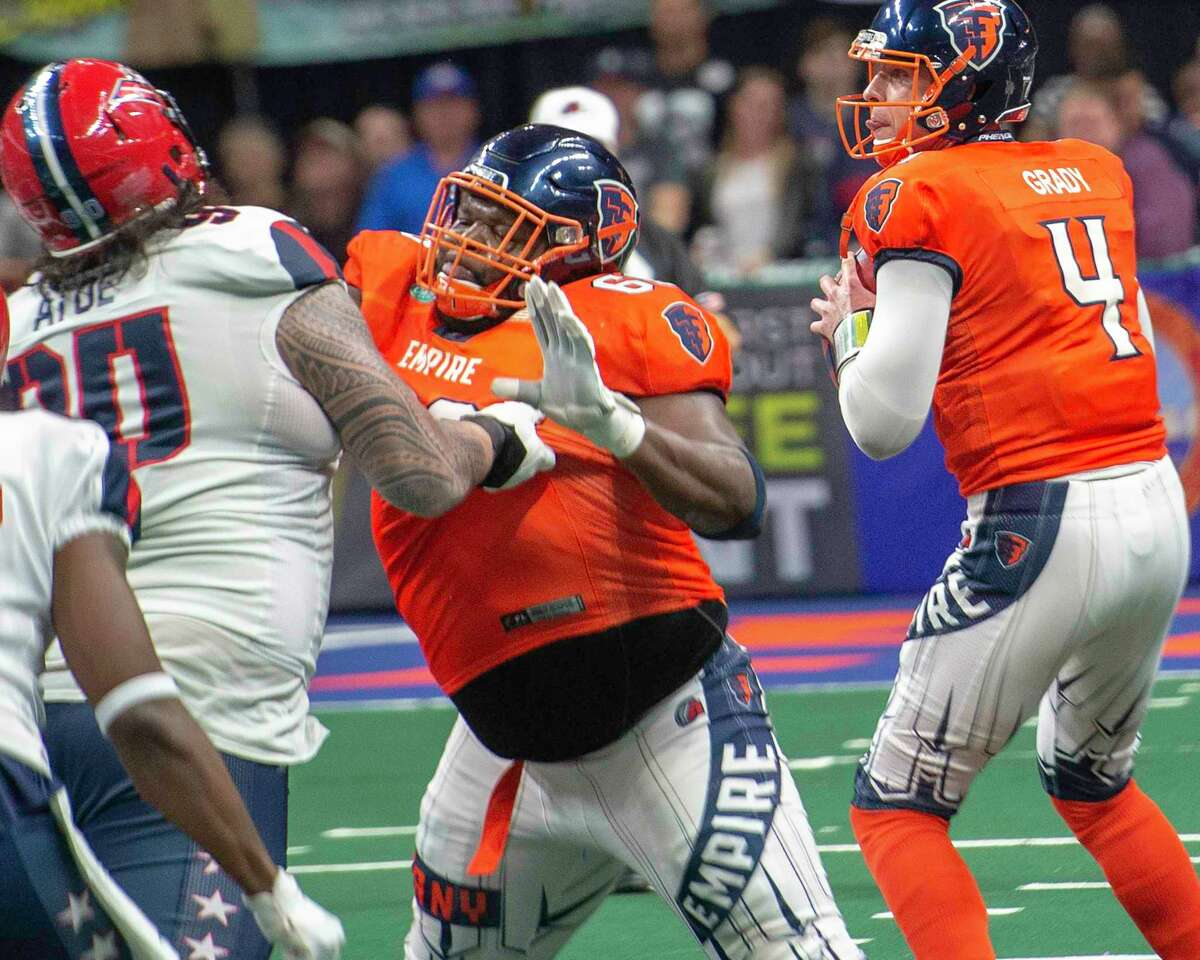 Albany Empire center Ryan Cave protects quarterback Tommy Grady during a game against the Washington Valor at the Times Union Center on Saturday, May 4, 2019 (Jim Franco/Special to the Times Union.)