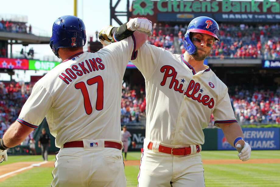 PHILADELPHIA, PA - MAY 18: Bryce Harper #3 of the Philadelphia Phillies is congratulated by Rhys Hoskins #17 after he hit a home run during the first inning of a game against the Colorado Rockies at Citizens Bank Park on May 18, 2019 in Philadelphia, Pennsylvania. (Photo by Rich Schultz/Getty Images) Photo: Rich Schultz / 2019 Getty Images
