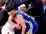 Golden State Warriors' Stephen Curry is fouled by Portland Trail Blazers' Seth Curry in 4th quarter during Warriors' 110-99 win in Game 3 of the NBA Western Conference Finals at Moda Center in Portland, Oregon on Saturday, May 18, 2019.