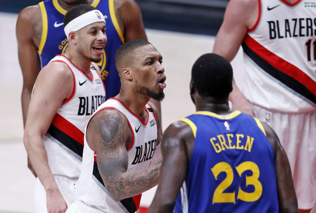 Portland Trail Blazers' Damian Lillard and Seth Curry react to a foul all during Warriors' 110-99 win in Game 3 of the NBA Western Conference Finals at Moda Center in Portland, Oregon on Saturday, May 18, 2019.