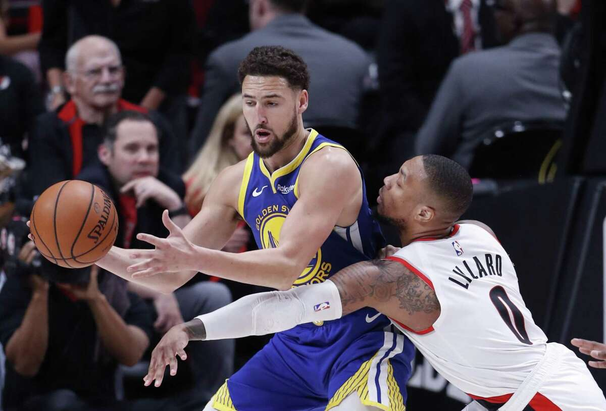 Golden State Warriors' Klay Thompson is defended by Portland Trail Blazers' Damian Lillard during Warriors' 110-99 win in Game 3 of the NBA Western Conference Finals at Moda Center in Portland, Oregon on Saturday, May 18, 2019.