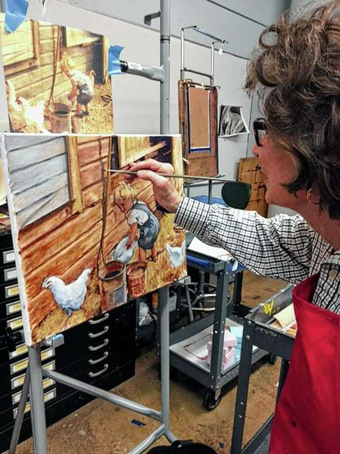 Shirley Harrold adds some finishing touches to a painting she created using a photograph as inspiration. Photo: Photo Provided