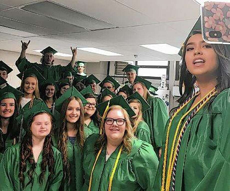 Members of the Carrollton High School graduating class of 2019 take a selfie Friday evening before the start of their graduation ceremony. Carrollton had 57 graduating seniors this year. Photo: Jim Caldwell | For The Journal-Courier