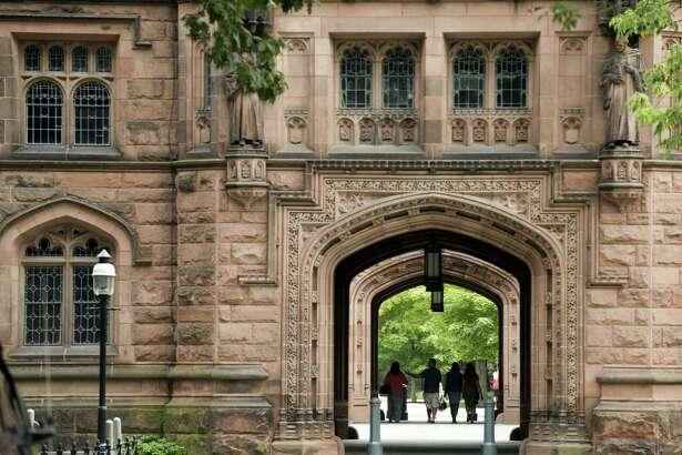 People walk on Princeton University campus in Princeton, New Jersey, on Aug. 30, 2013.