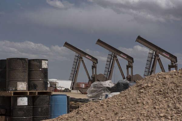 A row of pumpjacks is seen at a Diamondback Energy Inc. oil rig in Midland, Texas, on April 17, 2019.