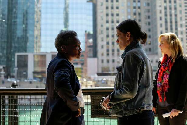 Chicago Mayor-elect Lori Lightfoot talks with a staff member on one of the final days of her transition team's work. The former federal prosecutor, whose election upended the city's political machine, will be sworn in Monday.
