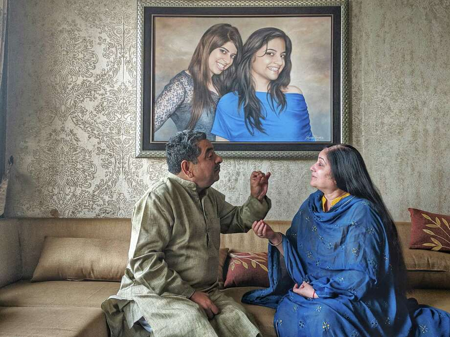 Sanjive and Seema Khanna argue over Prime Minister Narendra Modi at their home in Lucknow, India, this month. Photo: Washington Post Photo By Niha Masih / Niha Masih