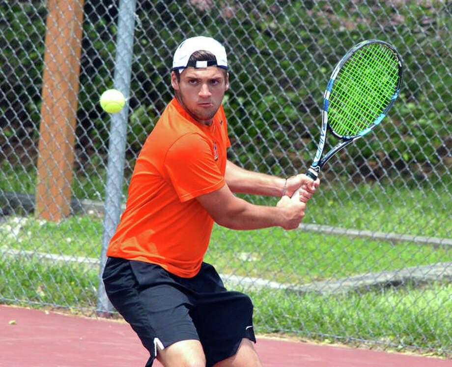 Edwardsville senior Seth Lipe makes a backhand return in his No. 1 doubles match during Saturday's Class 2A Edwardsville Sectional. Photo: Scott Marion/The Intelligencer