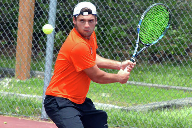 Edwardsville senior Seth Lipe makes a backhand return in his No. 1 doubles match during Saturday's Class 2A Edwardsville Sectional.