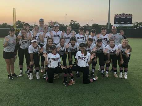 The Hargrave Lady Falcon softball team poses celebratorily after sweeping Lorena in the regional semifinals.