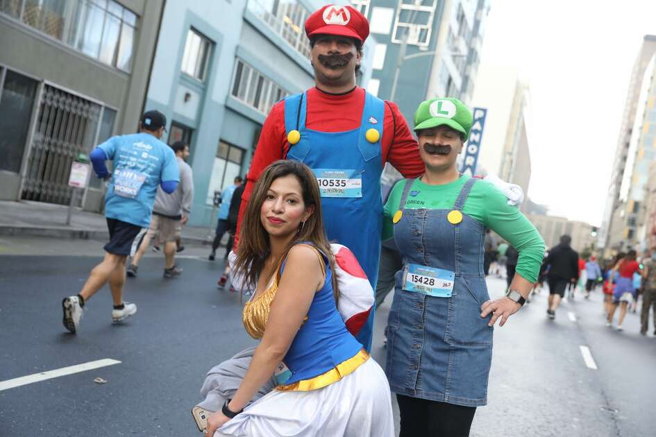 Runners celebrate, run, and brave the storm at Bay to Breakers 2019.