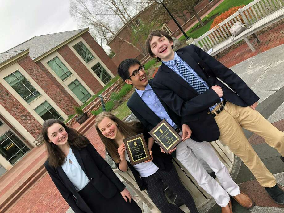 From left to right, Marissa Schrade, Claudia Meyer, Ali Siddiqi and Ben Fligelman, students at Joel Barlow High School, earned awards at a debate competition on April 28. Photo: / Contributed Photo