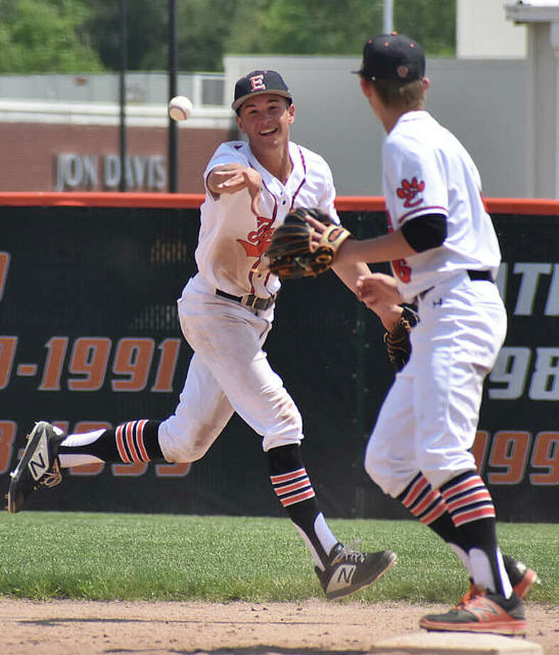 Edwardsville shortstop Josh Ohl, left, flips the ball to second baseman Logan Cromer to try for a force out against Springfield.