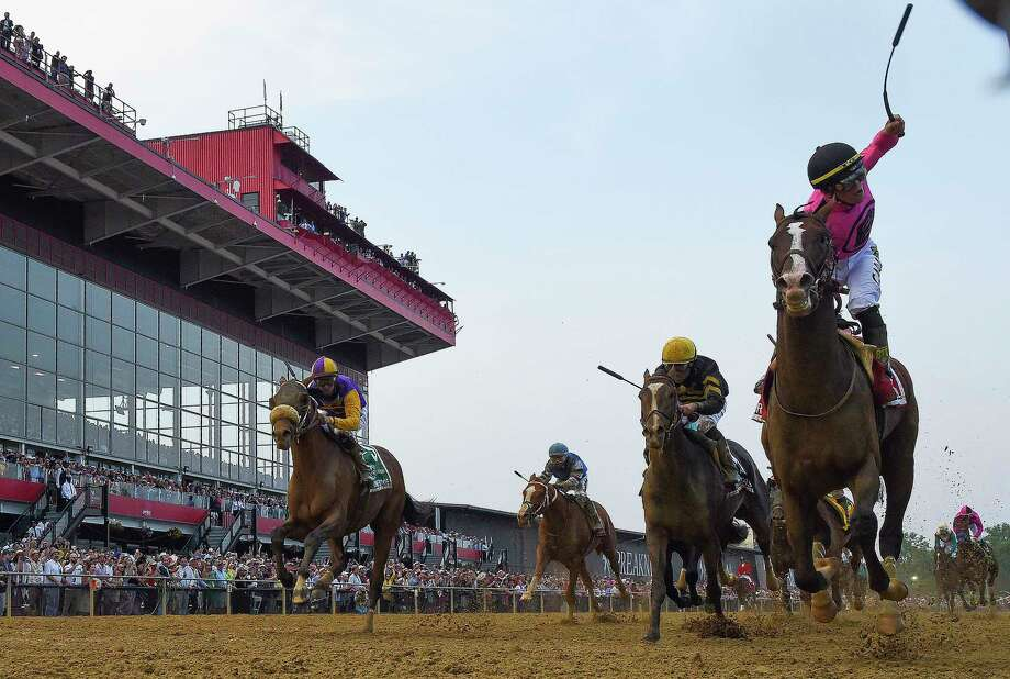 Tyler Gaffalione rides War of Will to victory in the Preakness. Photo: Washington Post Photo By Toni L. Sandys / The Washington Post