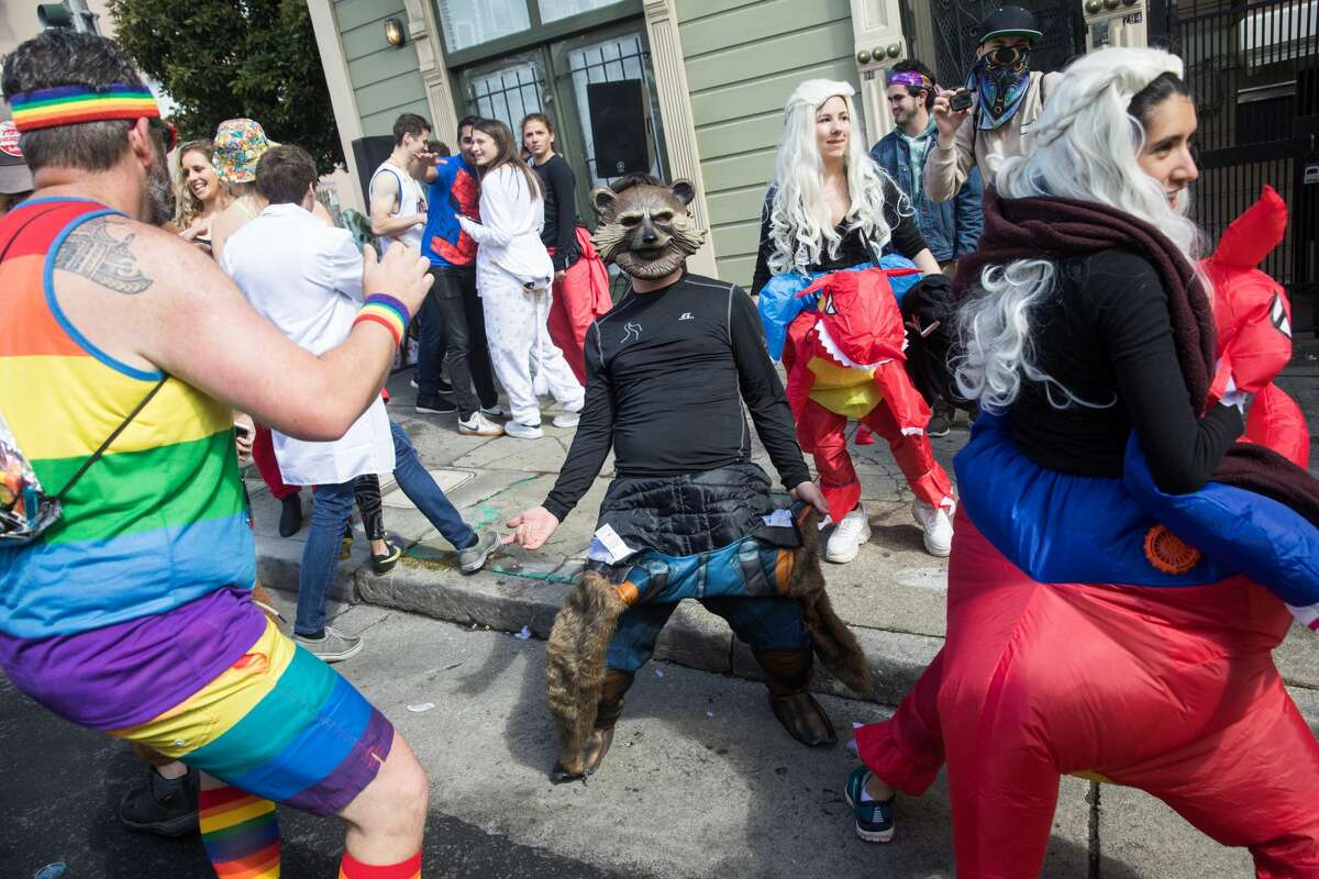 Runners and participants celebrate, run, and take part in the 2019 Bay to Breakers in San Francisco on May 19, 2019.