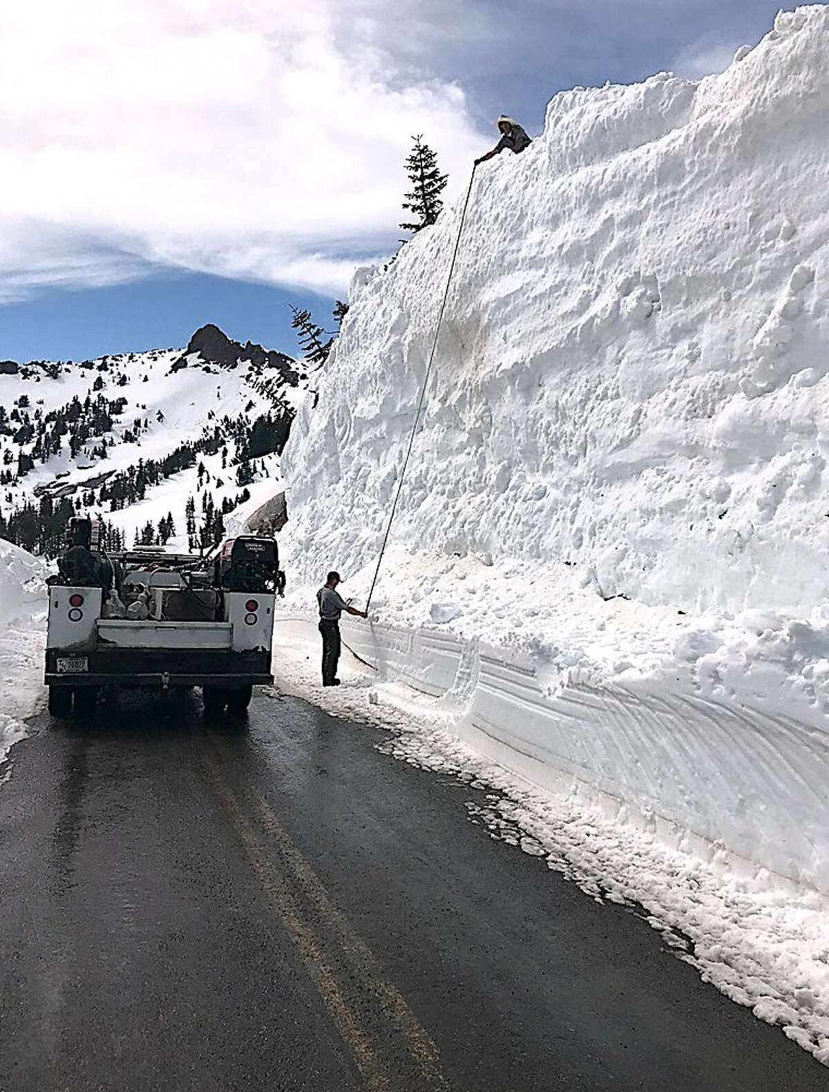 Road crews measured the snow wall at 28 feet high on the Lassen Park Highway at Lassen Volcanic National Park