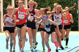 Staunton's Lydia Roller (2) leads the field in the 3,200 meters while runners inside clip heels and stumble just over 100 meters into the race Saturday at the Class 2A girls track state meet at Eastern Illinois University in Charleston.