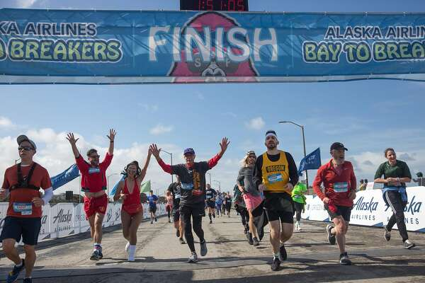 Bay to Breakers footrace gets wet and wild on San Francisco streets