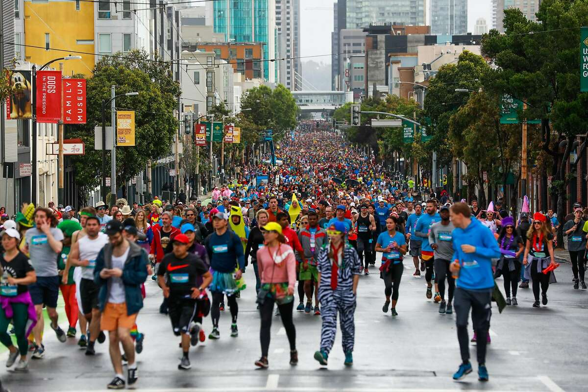 People run the Bay to Breakers race on Howard Street in San Francisco, California, on Sunday, May 19, 2019.