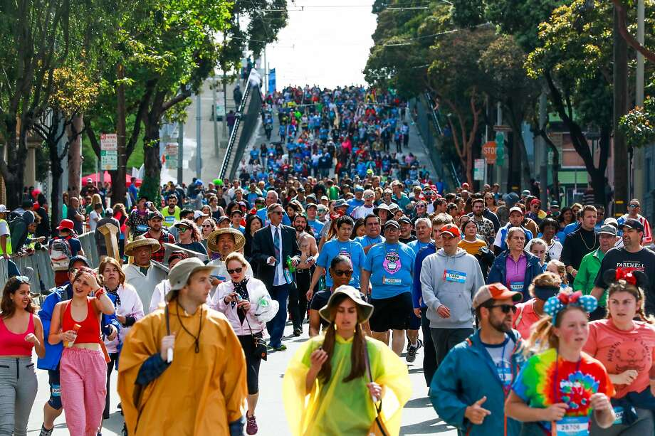 Hundreds of runners make their way down Hayes Street during the Bay to Breakers race.  Click ahead to see some of the best costumes from the 2019 event. Photo: Gabrielle Lurie / The Chronicle