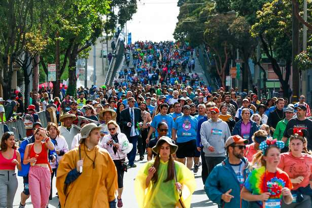 Hundreds of runners make their way down Hayes Street during the Bay to Breakers race in San Francisco, California, on Sunday, May 19, 2019.