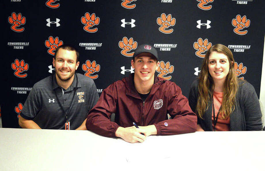 Edwardsville senior Porter LeVasseur, middle, signed with Missouri State University for swimming. Photo: Scott Marion/The Intelligencer