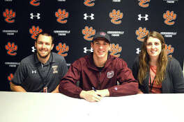 Edwardsville senior Porter LeVasseur, middle, signed with Missouri State University for swimming.