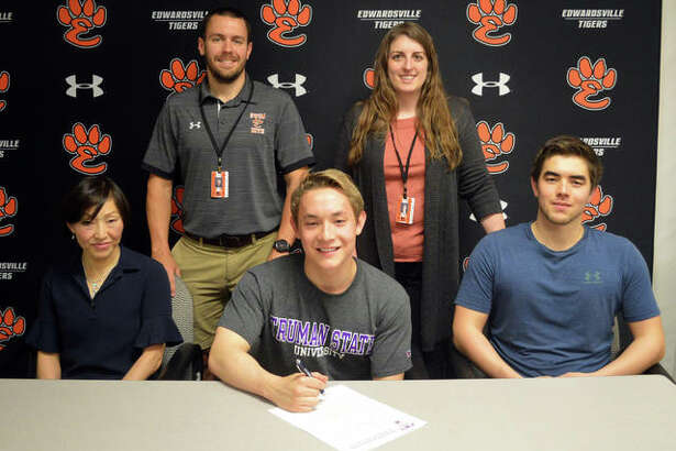 Edwardsville senior Noah May, seated middle, will swim for Truman State University.
