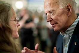 Former Vice President Joe Biden speaks to an Iowa voter in Dubuque on April 30, 2019.